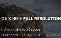 painting rock cliff sky